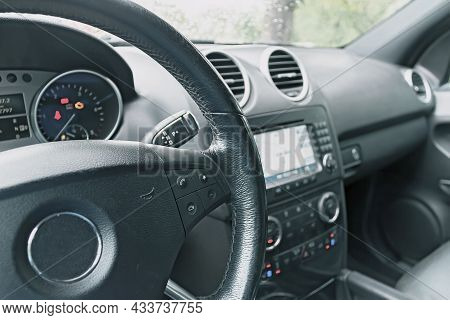 Vintage Toned Image Of A Car Interior. Close-up Of The Control Instrument Panel. Car Dashboard Detai