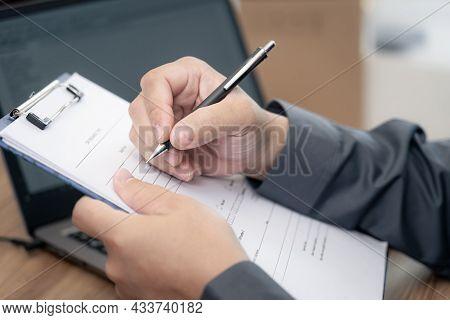 Car Service Staff Use Pen Check Paper List Of Car Service Cycle In Service Center Office And Use Lap