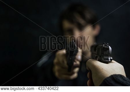 Mans Hand With Pistol Pointed At Criminal With Revolver. Shootout Of Two Thieves Or Murderers. Firea