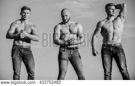 Full Of Energy. Inspiring Better Health. Three Muscular Men Sky. Athletic Bodybuilders. Sport Concep