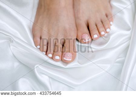 Beautiful French Pedicure In Pink And White With Rhinestones For The Bride. Toes Close Up. Wedding A