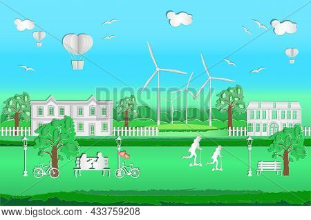Cityscape With Origami Houses, Hot Air Balloons, Windmills, Blue Sky, Clouds And People. Green Frien