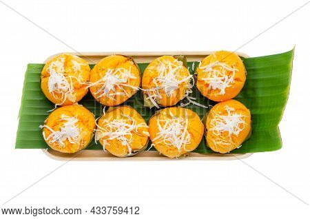 Group Of Delicious Homemade Toddy Palm Cake On Fresh Green Banana Leave And Wooden Tray Isolated On
