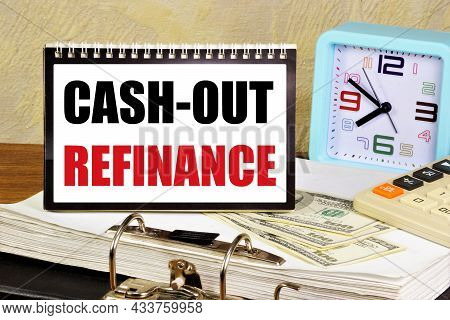 Cash-out Refinance. The Inscription In The Information Plate, On The Background Of The Calculator An