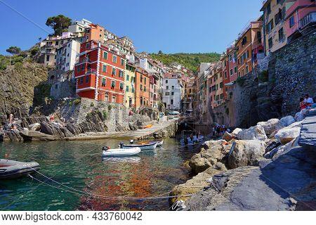 Riomaggiore, Italy - July 20, 2021: Riomaggiore Colorful Fishing Village, Seascape In Five Lands, Ci