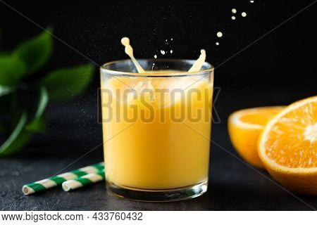 Orange Juice With Splash In A Glass