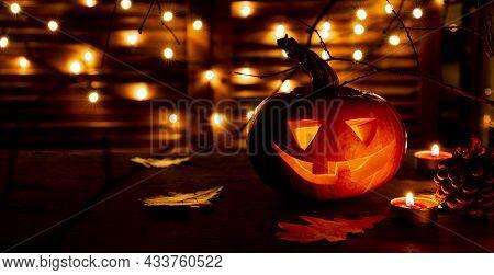 Traditional Halloween Pumpkin Glowing In The Dark. Halloween Greeting Card Concept, Dark Mood, Web B