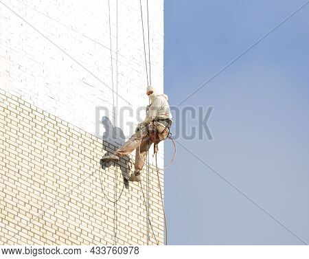 Industrial Climber On The Wall Of The House, Iskrovsky Prospekt, St. Petersburg, Russia, September 2