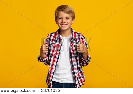 Cheerful Young Teen Boy Student Show Thumbs Up Sign Recommends Something For School