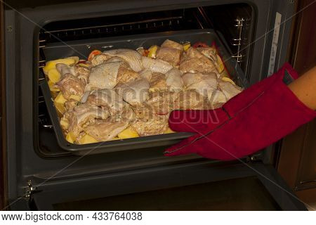 Cooking Chicken Meat With Potatoes. Baking Tray With Marinated Chicken Meat With Potatoes, Carrots A