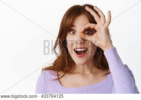 Close Up Portrait Of Excited Stylish Girl, Looking Through Ok Okay Sign Against Eye, Watching Someth