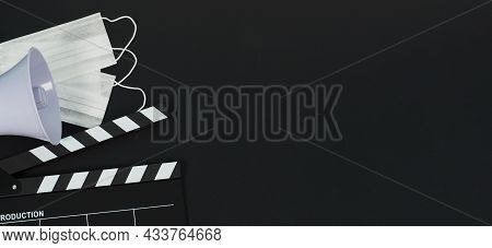 Black Clapper Board Or Movie Clapperboard Or Slate And Magaphone On Black Background.it Use In Video