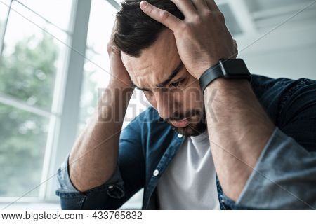 Very Upset Unhappy Man Suffering From Headache, Pain And Depression, Expresses Emotions Of Stress