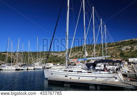 Primosten, Croatia - July 15, 2021: Sailboats Moored In Primosten Marina In Dalmatia. Croatia Is A F