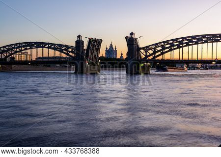The Bridging Of Bolsheokhtinsky Bridge On The Neva River Overlooking The Smolny Cathedral During The