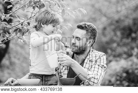 Always Carrying About Each Other. Happy Fathers Day. Little Boy With Dad Eat Cereal. Summer Picnic.