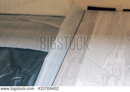 Laying The Laminate On A Base Of Waterproofing And Underlayment. The Master Installs The Laminate On