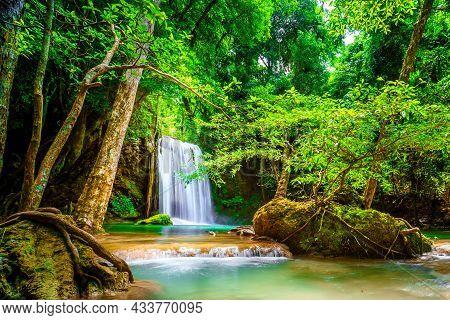 Waterfall In The Emerald Blue Water In Erawan National Park. Erawan Waterfall Is A Beautiful Natural
