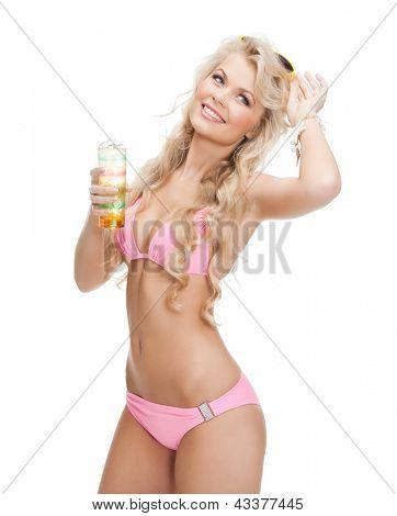 woman in bikini with glass of juice or cocktail