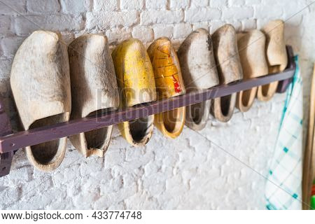 Rack Of Dutch Clogs On Wall In Selective Focus In Line