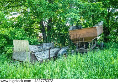 Couple Of Rusty And Weathered Old Wagons Obsolete Farm Equipment Dumped In A Overgrown Farm Field Ro