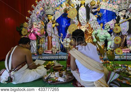 Howrah, West Bengal, India - 24th October 2020 : Touching Lord Ganesha With Belpata Tied Stick. Pran