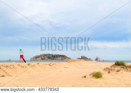 Empty beach with islands Les Medes in Spanish Estartit