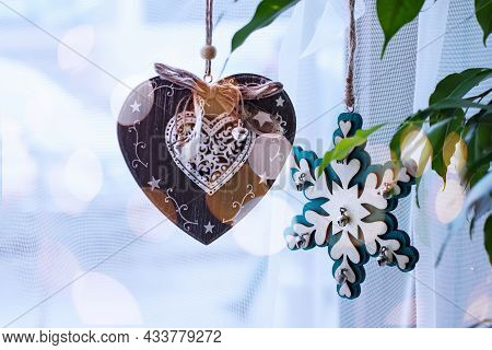 Festive Decoration Of The Window With Handmade Vintage Christmas Toys In The Shape Of A Heart And Sn