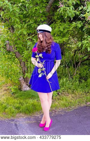 Just Graduated Secondary School Graduate With Her Hat And Holding A Rose.