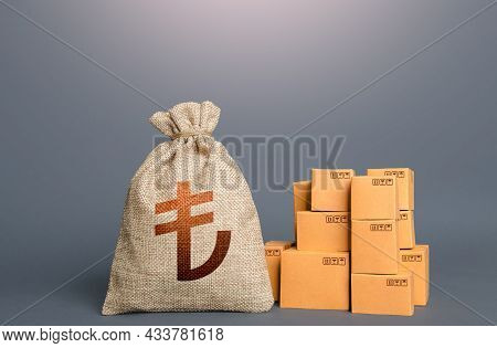 Boxes And Turkish Lira Money Bag. The Concept Of Trade In Goods And Production. Profit From Trading.
