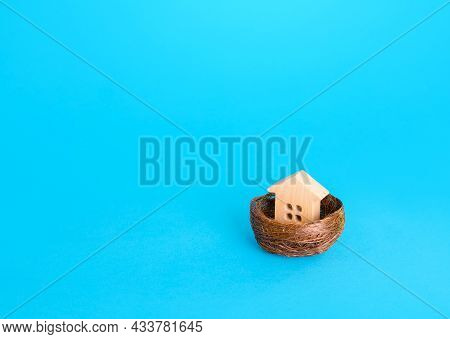 Figurine Of A House In A Birds Nest. Home Security Concept, Real Estate Insurance. Mortgage Credit L