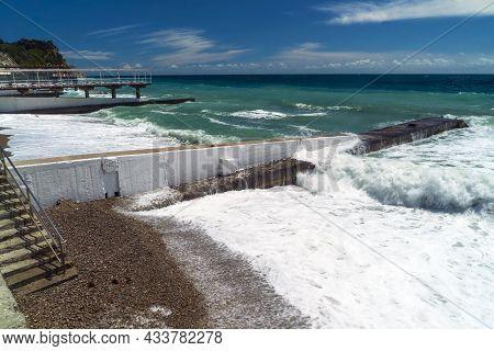 The Sea Is Stormy. Large Waves Break On The Breakwater .crimea