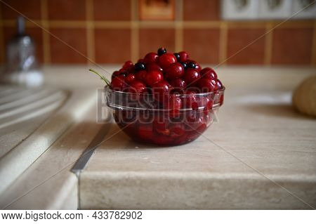 Close-up Food Picture Of Fresh Sweet Delicious Ready-to-eat Ripe Cherry Berries In Transparent Glass