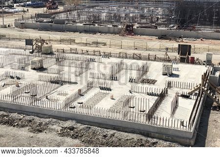 Reinforced Concrete Foundation And Metal Reinforcement Outlets. Construction Site Of Industrial Buil