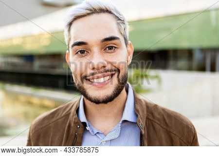 Young Hispanic Man Smiling On Camera Outdoors - Portrait Of Happy Trendy Guy In The City - Millennia