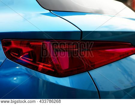 Rear Led Headlamp Of A Modern Car. Brake Taillight. Red Stop Lighting Of Highway Vehicles. Cars Ambi