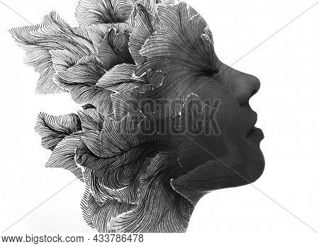 Double exposure portrait of a sensual young woman combined with aan abstract shape representing her thought and feelings. Paintography