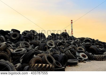 Waste Tires And Tyres At Landfill For Recycling. Regenerated Tire Rubber Produced. Reuse Of The Wast