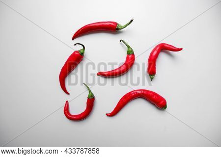 Red Hot Chili Peppers On A White Background. Natural Seasoning. Fresh Red Chili Pepper. Hot Pepper.