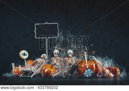 Halloween Skeletons Having Spooky Party With Pumpkin And Spider