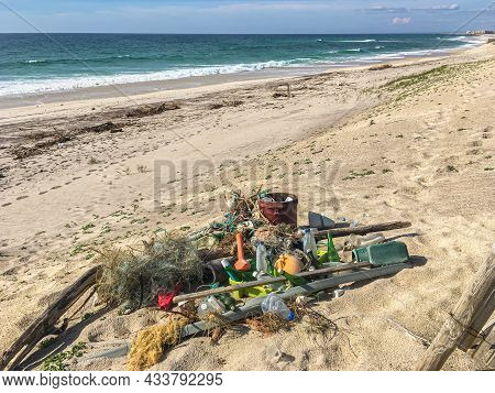 Plastic Waste On Furadouro Beach In Ovar, Portugal. Trash, Plastic, Garbage, Bottle. Environmental P