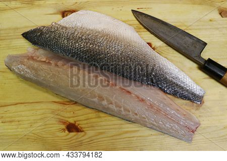 Fresh Atlantic Sea Bass Fillet On A Wooden Board In Close Up