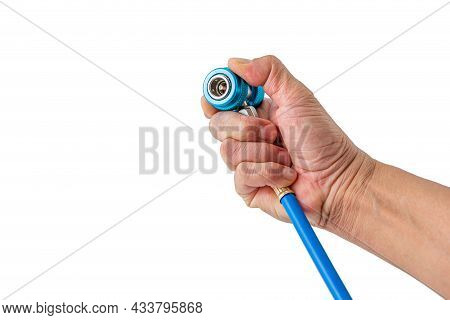 Refrigeration Tool : Man Hand Holding A Quick Coupler Adapters For Refrigeration Charging Hose Tube
