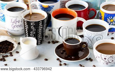 Close Up Of Many Cups Of Coffee In Various Mugs And Cups.