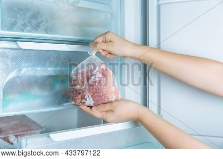 Taking frozen meat from the modern no-frost freezer