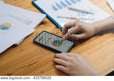 Close-up Of A Business Woman Audit The Companys Budget. Tax Information Is Calculated By Accountants