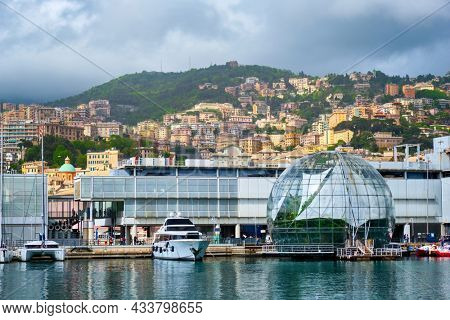 Old Port Porto Antico of Genoa (Genova) with yachts and boats with aquarium biosphere building under stormy sky. Genoa, Italy