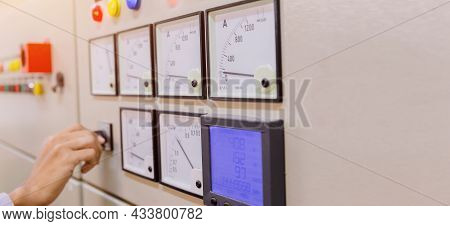 Engineer Is Check Voltage Or Current By Voltmeter In Control Panel Of Power Plant And Check System R