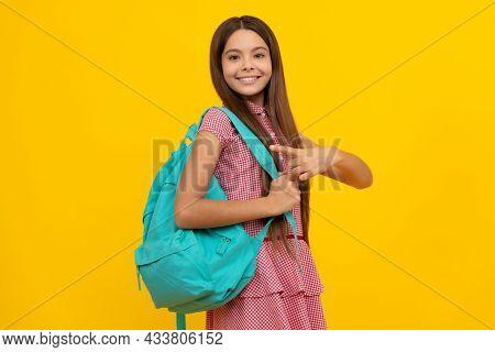 Happy School Teen Girl Point Finger On Backpack On Yellow Background, September