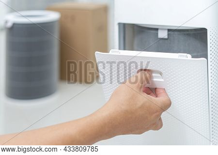 Hand A Man Open The Lid Of The Air Purifier Check And Change Filter In Side Air Purifier For Dust Re